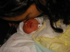 Mommy kissing Pedro Jose
